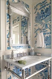 white and blue powder room features walls clad in trim molding