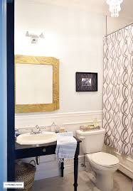 how i m updating our small bath for less than 500 small bathroom with white wainscotting light blue walls black vanity and gold accents
