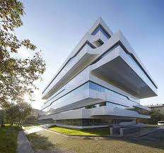 office plus zaha hadid designs commercial office structure clad in alucobond plus