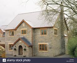 english style house miraculous exterior of new build stone country style house stock