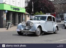 vintage bentley vintage bentley car driving along market street carnforth stock