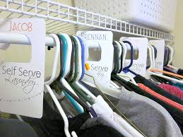 easy way to do laundry closet divider organizer hanger labels for
