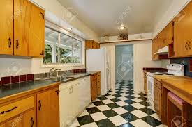 kitchen cabinets with white tile floors narrow kitchen room interior with black and white tile floor