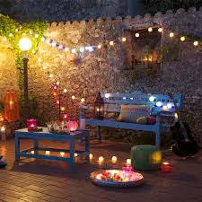 french country cottage evening view twinkling christmas lights