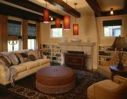 stunning warm colours for living rooms with white fireplace and