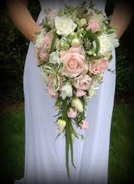 wedding flowers near me garden cascade bouquet with roses peonies and delphiniums in