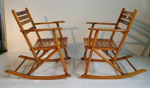 pair modernist folding slatted rocking chairs by telescope