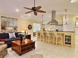 tropical great room with ceiling fan u0026 built in bookshelf in vero