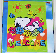 snoopy sleeping in flowers welcome large flag collectpeanuts