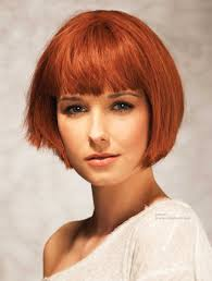 chin length bob with just above the eye brows bangs red hair