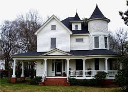 lovely white country victorian style house black roof with
