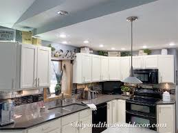 how to paint above kitchen cabinets decorating above kitchen cabinets beyond the wood diy