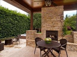 craftsman patio with stacked stone fireplace by eduardo mendoza
