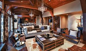 steampunk interior design where old meets new furnishmyway blog steampunk interior design living room chandeliers area rug lamps wooden ceilings with exposed beams