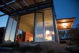 eco friendly home glass walls patio doors evening lighting simple eco friendly