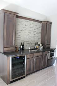 hickory grey stained kitchen cabinets hickory bar in warm gray stain with brushed granite