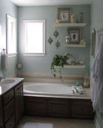 bathroom wall idea bath panel to match sink cabinet and floating shelves for decorative