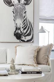 zebra art over white sofa contemporary living room