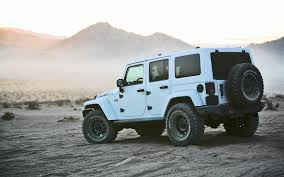 jeep wrangler white 4 door why are jeeps so ridiculously expensive