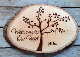 welcome to our nest wood burned sign with blossom tree and love