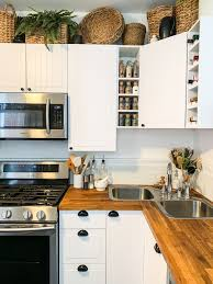 what to put on top of kitchen cabinets for decoration decorating above kitchen cabinets with baskets and plants