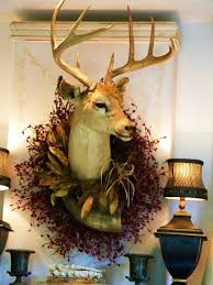 Christmas Decorations With Deer by Deer Head Decorated With A Wreath At Christmas Holiday U0027s