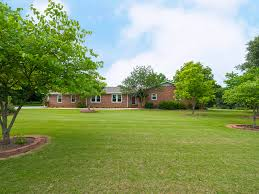 reduced 8 13 acres 2 200 sq ft brick ranch with detached