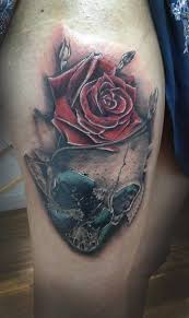 skull n rose tattoo on thigh by dontas lasys