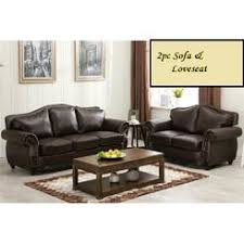 brown leather sofa and loveseat carved wood trim leather sofa