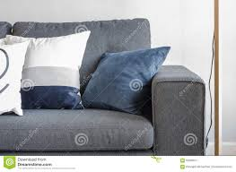 blue and gray sofa pillows surprise blue and grey throw pillows on modern sofa stock image
