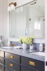 is black hardware in style black caign style washstand with brass hardware