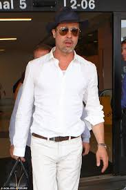 brad pitt sports all white ensemble and big smile as he walks