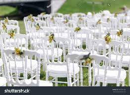 white chairs wedding ceremony beautiful wedding stock photo