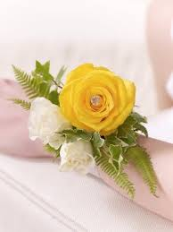 yellow rose and fern wrist corsage inverurie flowers