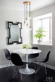 round table marlow rd black and white dining room boasts a hudson valley marlow aged brass