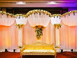 colorful flower decorated wedding couple stage for indoor wedding