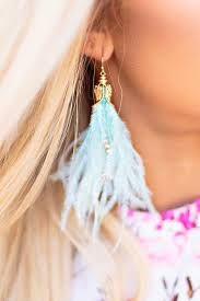 feather earrings playful in feather earrings impressions online boutique
