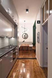tiny student apartment in poznan works magic with limited space view in gallery tiny kitchen and dining space idea for the small urban apartment