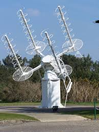 a helical antenna is an antenna consisting of a conducting wire
