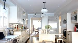 pendant lighting over island kitchen traditional with barstools