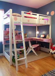 bedroom high bunk beds with stairs and white bedding plus