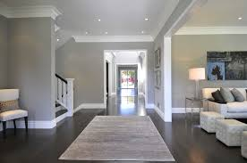 Best Way To Protect Hardwood Floors From Furniture by Dark Floors And Light Grey Walls With Neutral Furniture And Wall