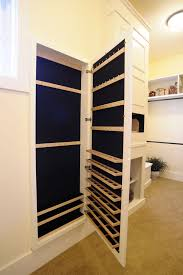 between the studs gun cabinet jewelry armoire mirror in closet traditional with spice cabinet next