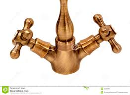 and cold base of a brass kitchen faucet royalty free stock