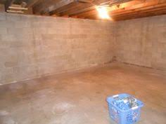 Inexpensive Unfinished Basement Ideas by Use Pegboard To Cover The Walls And To Hang Shelves In An