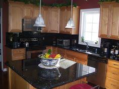 black backsplash in kitchen lexar homes open kitchen with granite countertops lexar