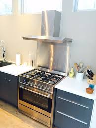 kitchen style gray cabinet long chrome handles canopy range hood