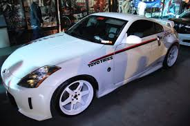 white nissan 350z nissan 350z with white volk rims 1 madwhips