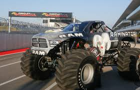 videos of monster trucks crushing cars dodge raminator monster truck breaks speed record