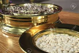 communion plates communion plates with the bread and wine ready to be served stock